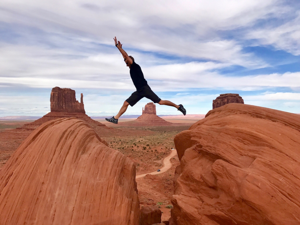 Man jumping across a canyon.