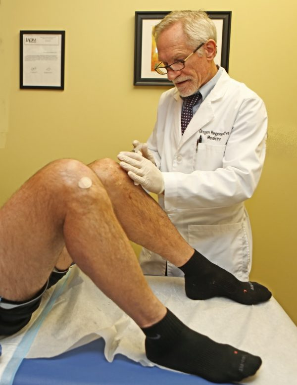 Dr. Noel Peterson demonstrating stem cell results for patient with knee OA