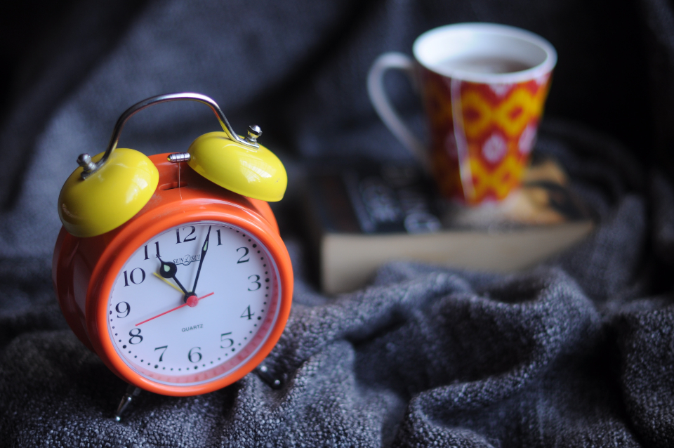 herbal tea and a relaxing book can help you get to bed earlier right before and after daylight saving time