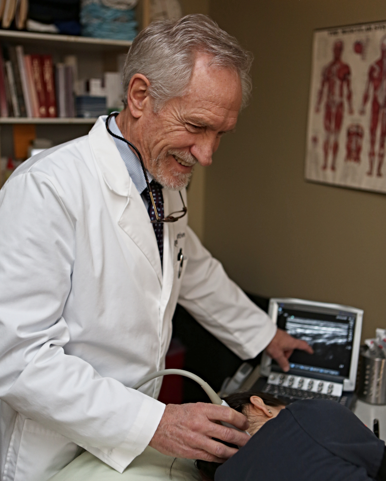 Dr. Noel Peterson performing ultrasound-guided nerve pain treatment